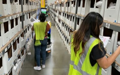 man and woman working in a warehouse