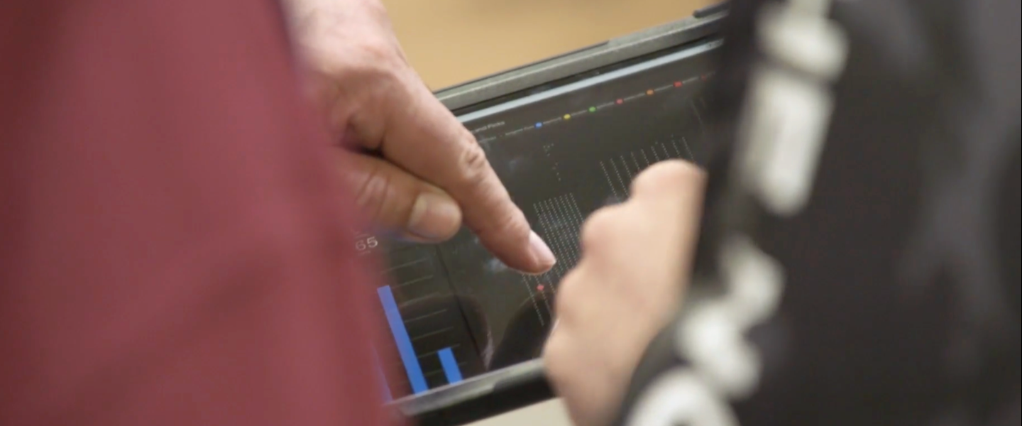 hand touching a tablet screen