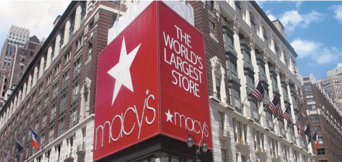 sign on corner of macy's location in new york