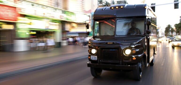 UPS truck driving down a street