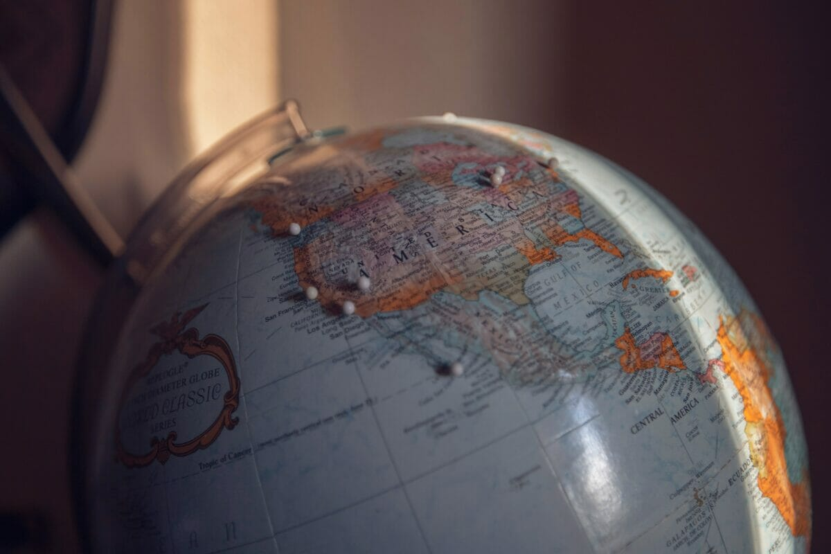 globe with pin makers on locations