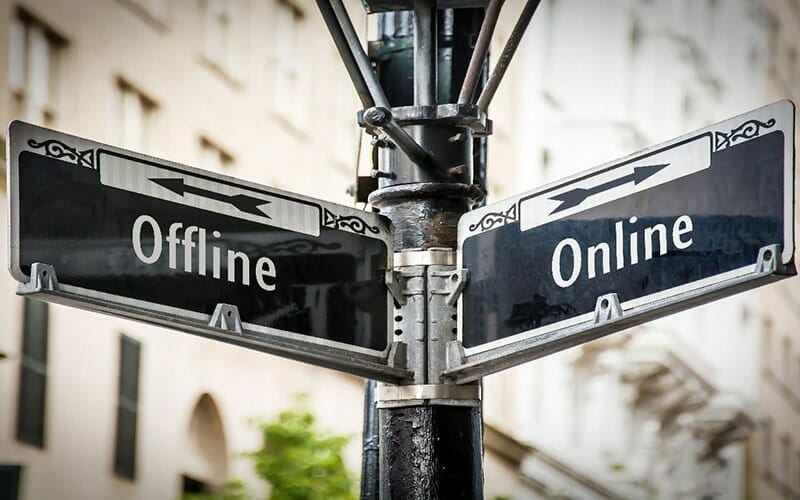 black and white street post with two signs: 'offline' and 'online'. each sign has an arrow pointing in a different direction.