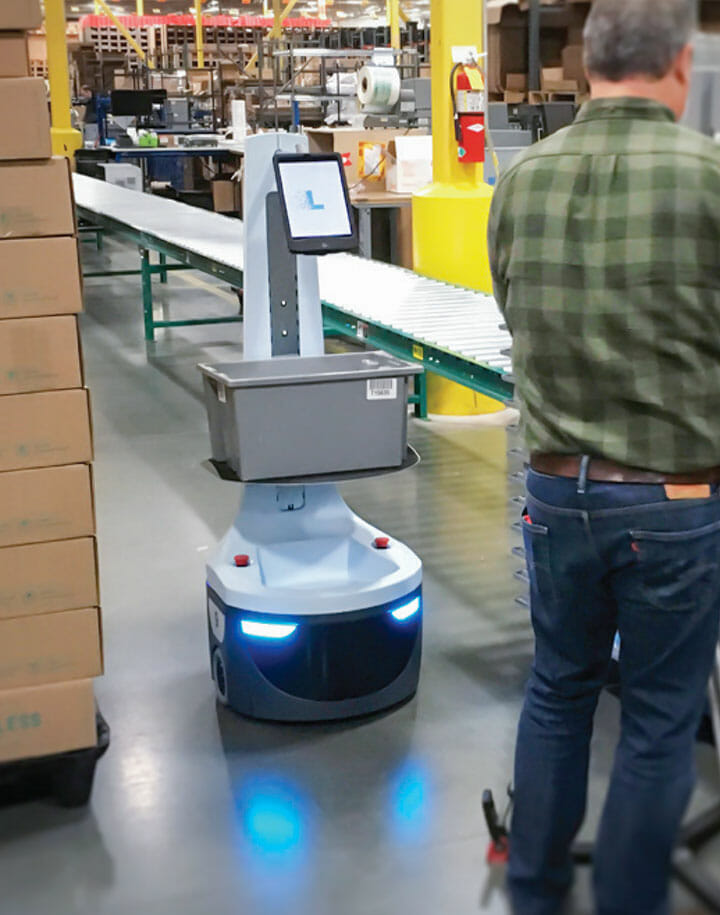 Robot assisting a warehouse worker in picking items