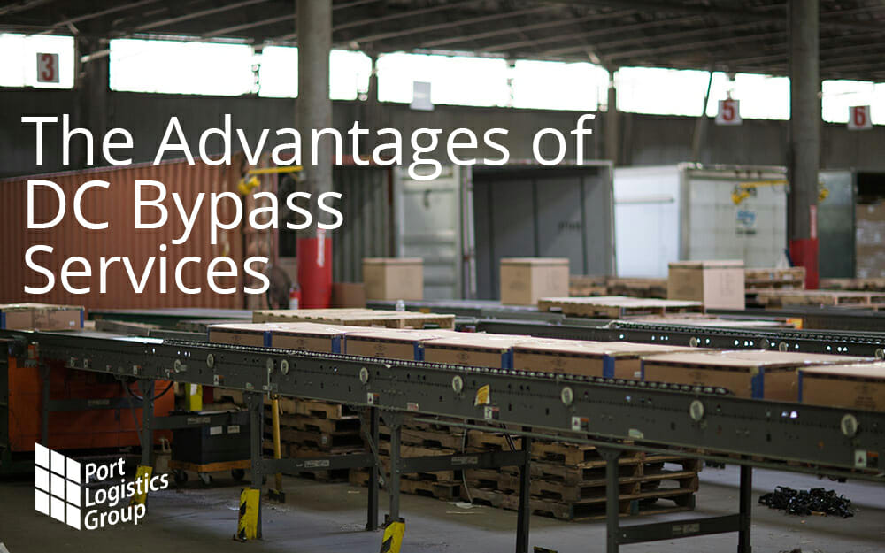 Conveyors with boxes being sorted at a distribution center for loading into tractor trailer trucks in the back.