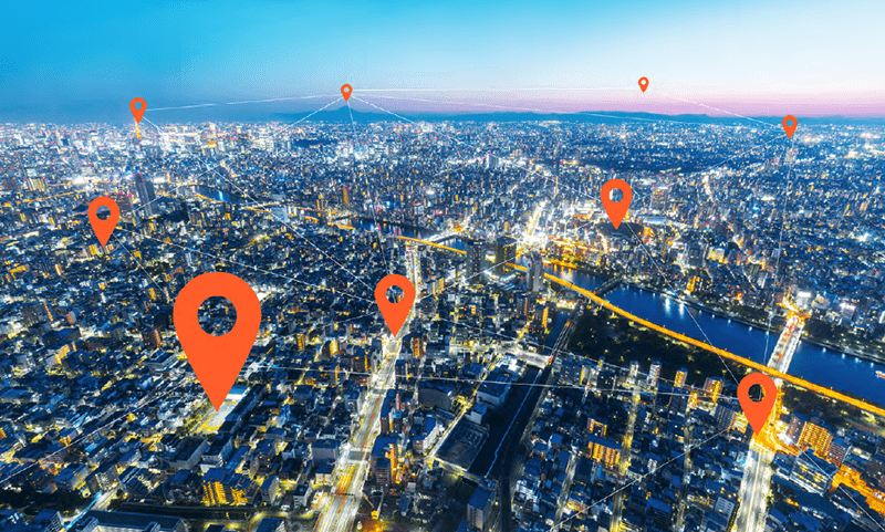 aerial view of a city with location markers pointing to different locations