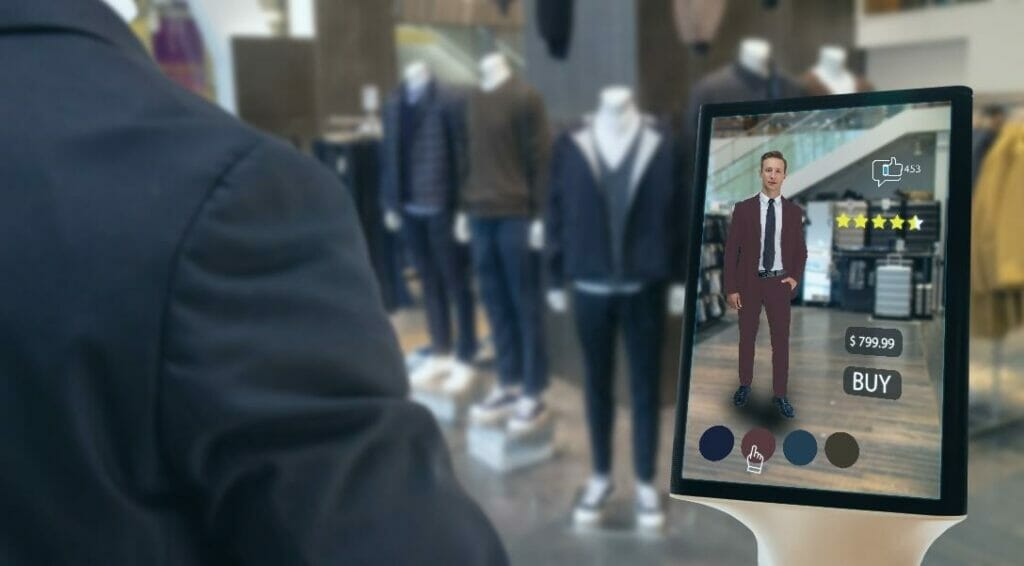 Man virtually trying on a suit using augmented reality software on a tablet