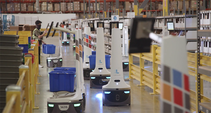 warehouse aisle at port logistics group populated with locusbots to help fulfill orders