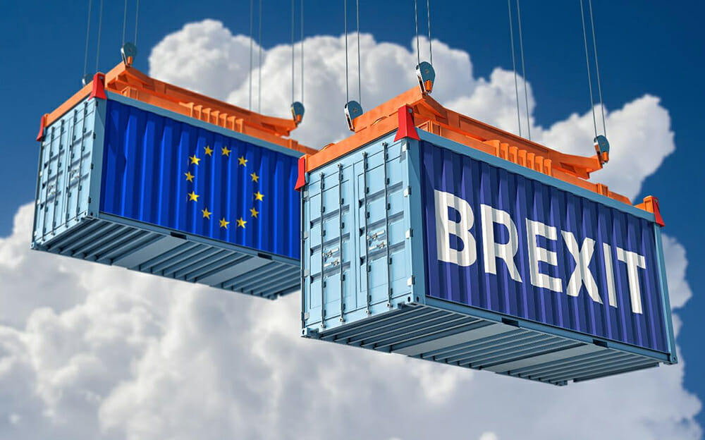 Two shipping crates suspended from wires with the word 'Brexit' on one and the European Union flag on the other