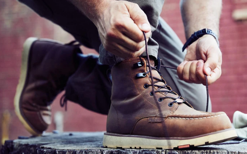 hands tying the laces on brunt boots