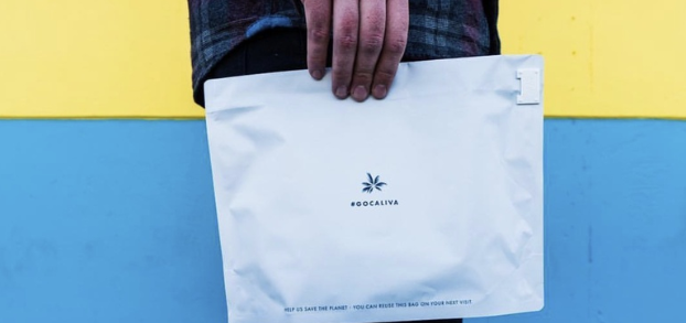 hand holding caliva cannabis package
