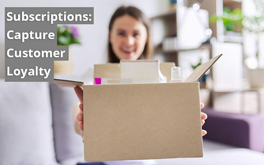 A cardboard box opened on the top with products inside. A consumer holding the box and smiling in the background. Headline: Subscriptions - Capture Customer Loyalty