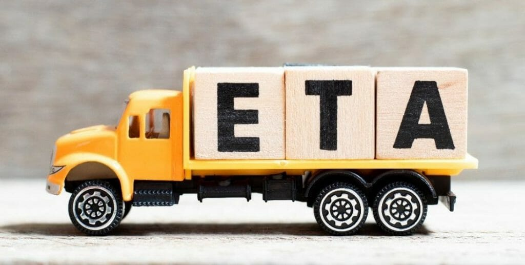 Toy flatbed truck with three large blocks on the back. Each block has a capital letter that together spell ETA.