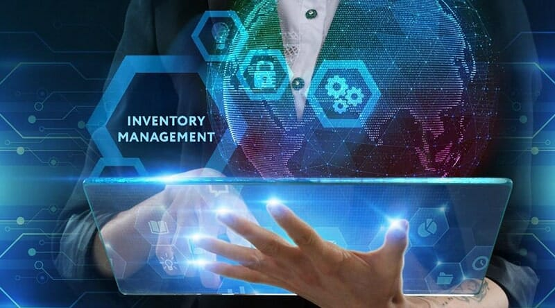 Woman holding and touching a translucent tablet with her finger with hexagons and icons surrounding the words 'inventory management'