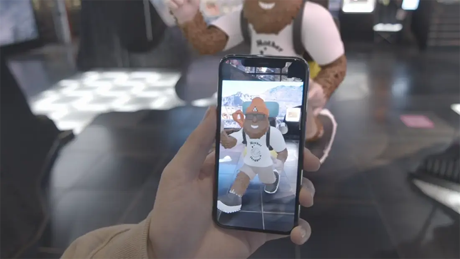 a person holding a smartphone in their hand with an AR character on the screen