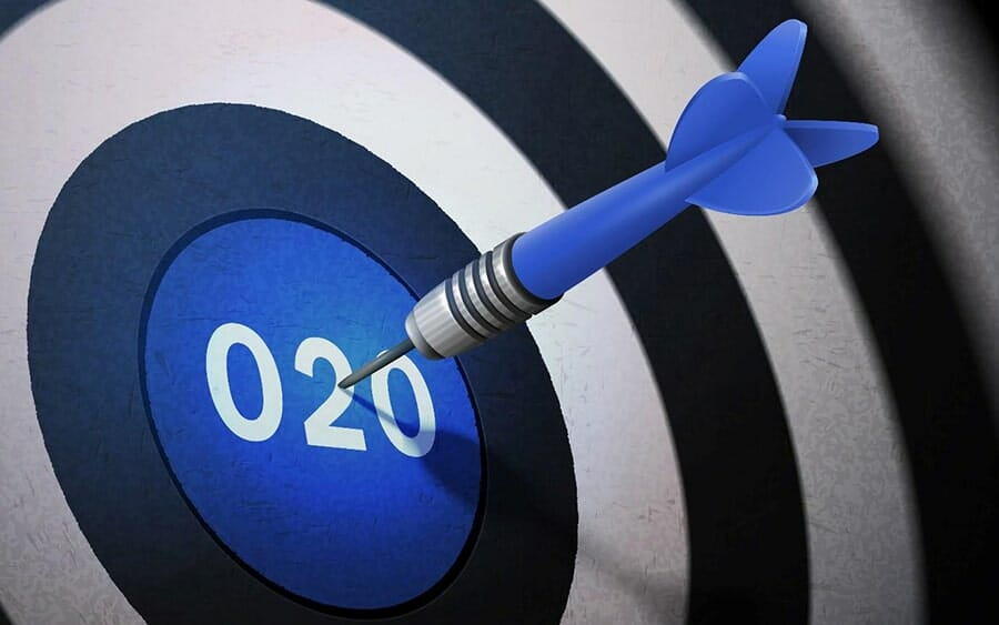 a blue dartboard with a bullseye that says O2O. there is a dart in the bullseye.