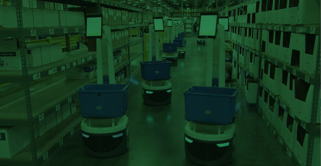 green-tinted image of locusbots in a warehouse