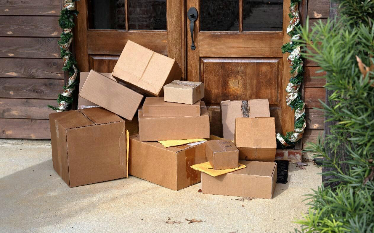 ecommerce fulfillment shipment boxes at a customer door