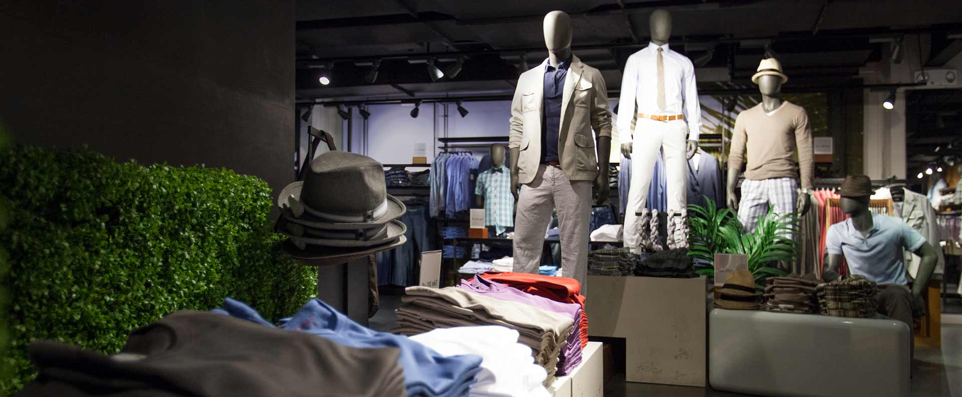 Mannequins and clothing in a men's store display