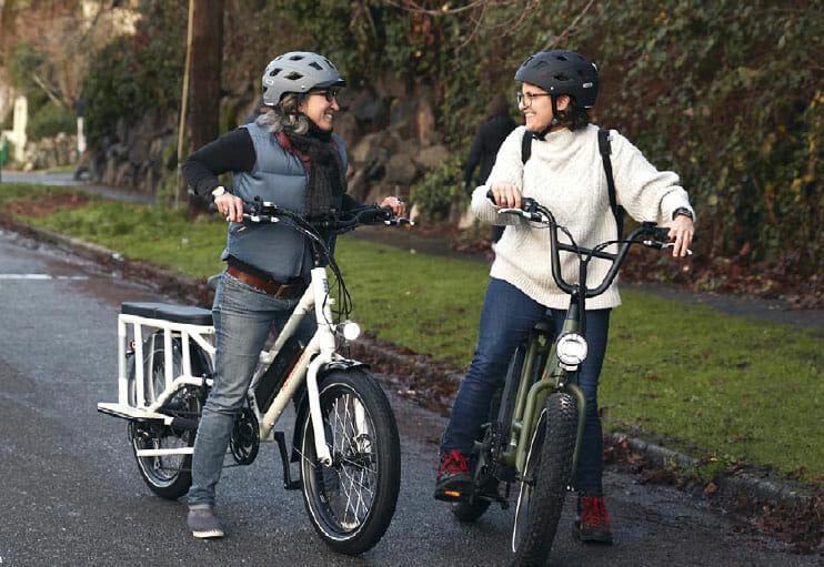 two women talking on rad road bikes