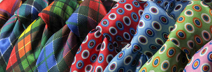 assortment of colorful mens' ties