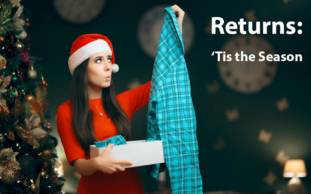 Woman holding up blue plaid pajamas Christmas present and making a disappointed face with the text 'returns: tis the season'