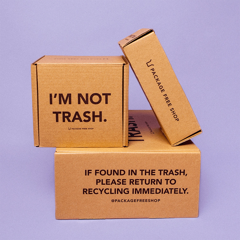 reusable packaging with 'i'm not trash' and 'if found in the trash, please return to recycling immediately'.