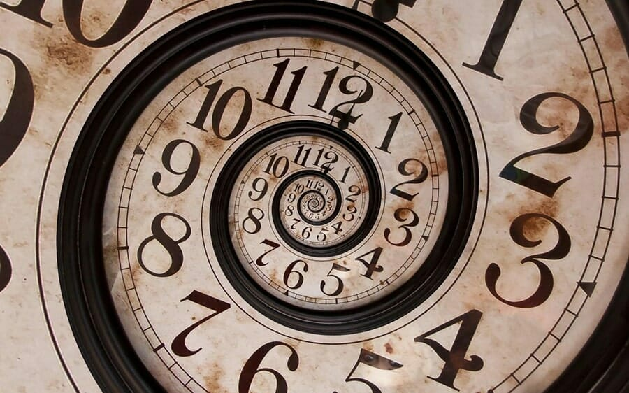 closeup of a brown wood and tan clock face spiraling into itself