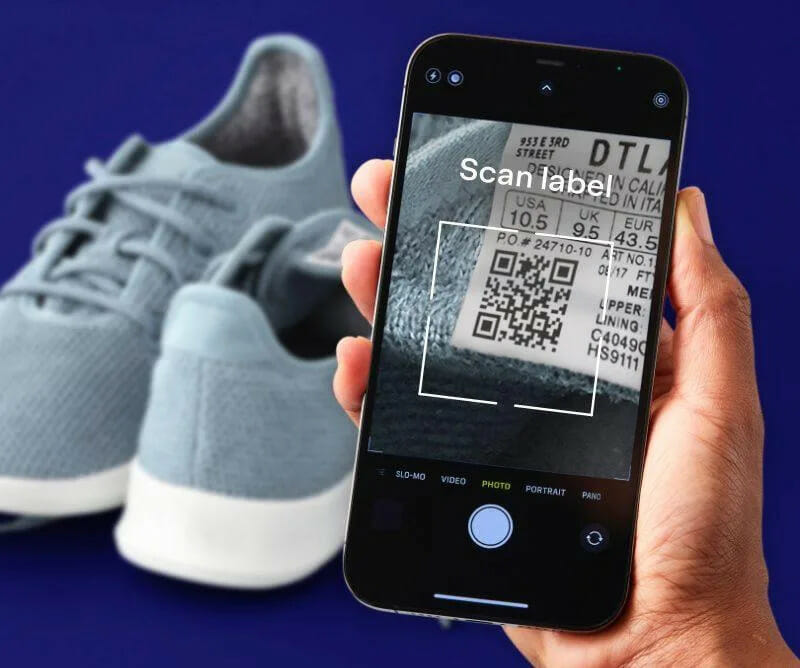 a person scanning shoe labels with their phone
