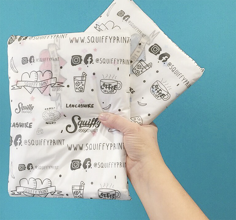 products from Squiffy Print wrapped with tissue paper with logos