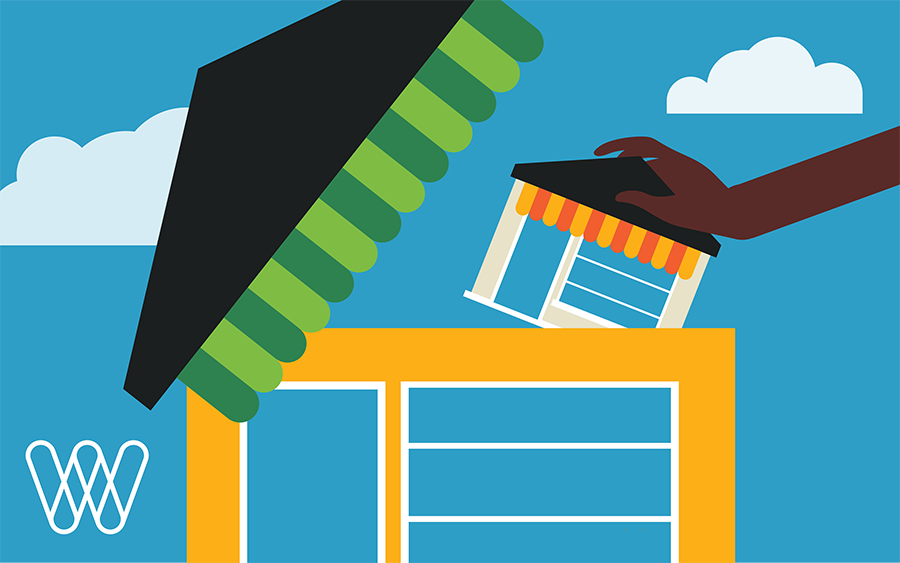 illustration of a hand placing a storefront within another store building