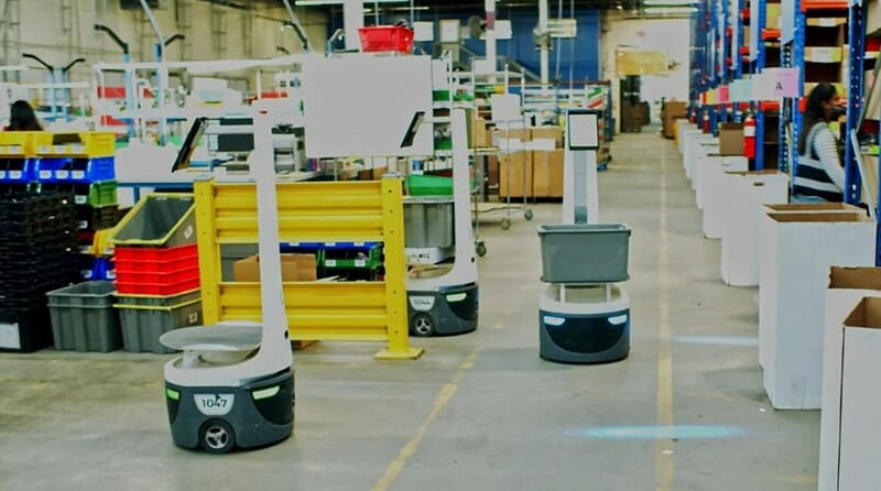 interior of a warehouse with robots fulfilling ecommerce orders
