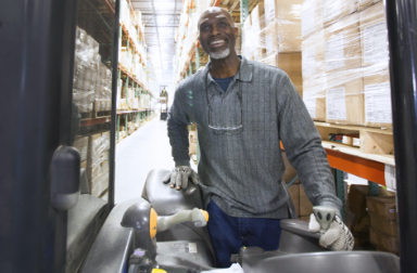 smiling man working in a warehouse