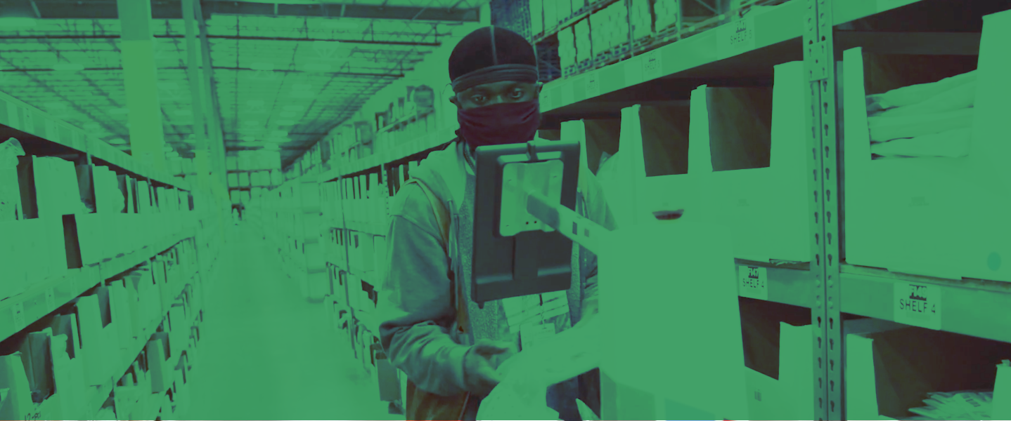 green-tinted image of a man working with a locusbot
